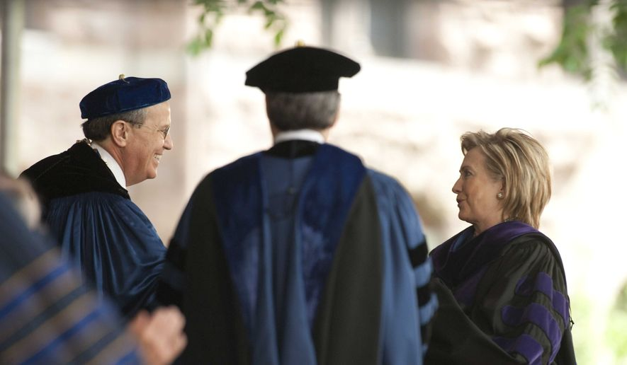 Secretary of State Hillary Rodham Clinton receives an honorary Doctor of Laws degree from Provost Peter Salovey center, and University President Richard Levin, left, at the Yale University commencement in New Haven, Conn. Monday, May 25, 2009. Clinton is a Yale Law School graduate and met Bill Clinton there in 1970.