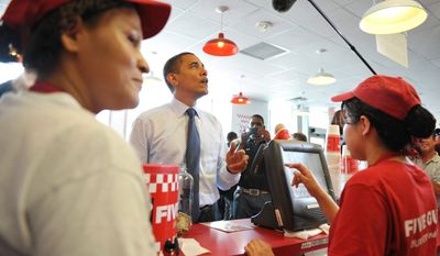 AGENCE FRANCE-PRESSE/GETTY IMAGES President Obama orders cheeseburgers at a Five Guys restaurant in Washington on Friday during a surprise lunch stop that his spokesman attributed to hunger and not an appetite for the cameras following him.