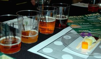 DAVID JOHNSON Craft beer (top) can be dark and more flavorful than wine, its boosters say. A line forms (below) for admission into Savor, a beer-and-food-pairing festival (above) held Saturday at the National Building Museum.