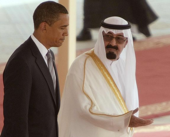 King Abdullah of Saudi Arabia, right, welcomes US President Barack Obama, left, on his arrival at the Royal Terminal of the King Khalid International Airport, in Riyadh, Saudi Arabia, Wednesday, June 3, 2009. (AP Photo/Hassan Ammar)