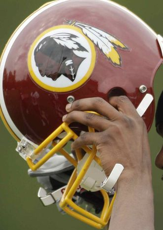 ** FILE  ** In this May 1, 2009, file photo, Washington Redskins Marko Mitchell puts his helmet on during their NFL football minicamp practice at their training facility in Ashburn, Va. The Washington Redskins won another legal victory Friday, May 15, 2009, in a 17-year fight with a group of American Indians who argue the football team's trademark is racially offensive. The decision issued Friday by the U.S. Court of Appeals in Washington doesn't address the main question of racism at the center of the case. Instead, it upholds the lower court's decision in favor of the football team on a legal technicality. (AP Photo/Alex Brandon, File)