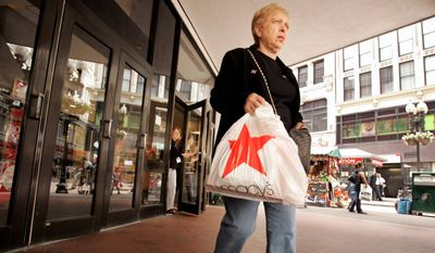 Adeline Carino was shopping at the Macy's store in Boston on Thursday as retailers were reporting disappointing sales for May. (Associated Press) ** FILE **