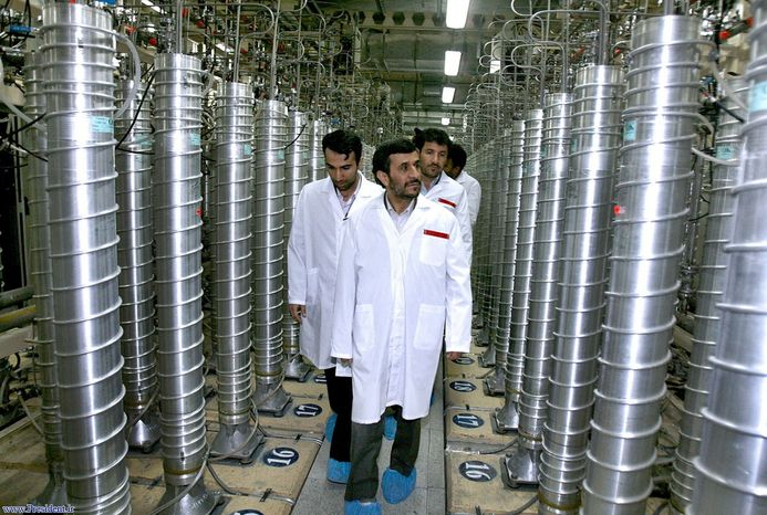 **FILE** Iranian President Mahmoud Ahmadinejad (center) visits the Natanz Uranium Enrichment Facility, about 200 miles south of the capital, Tehran, in April 2008. (Associated Press)
