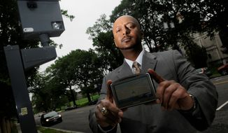 "Joe Scott says his Global Positioning System software helps warn drivers of about speed traps and red-light cameras, such as the one at Michigan Avenue at Trinity, or the Third Street tunnel to Interstate 395. Mr. Scott says his software will ""help GPS owners to legally avoid unjust traffic tickets."" (Peter Lockley/The Washington Times)"
