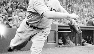 Associated Press In 1936, Bob Feller struck out 15 St. Louis Browns batters in his first major league start.