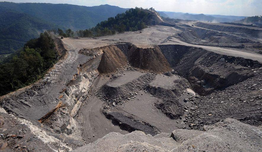 Association Press Coal River Mountain (left) forms the backdrop for a mountaintop coal-mining site at Kayford Mountain, W.Va.