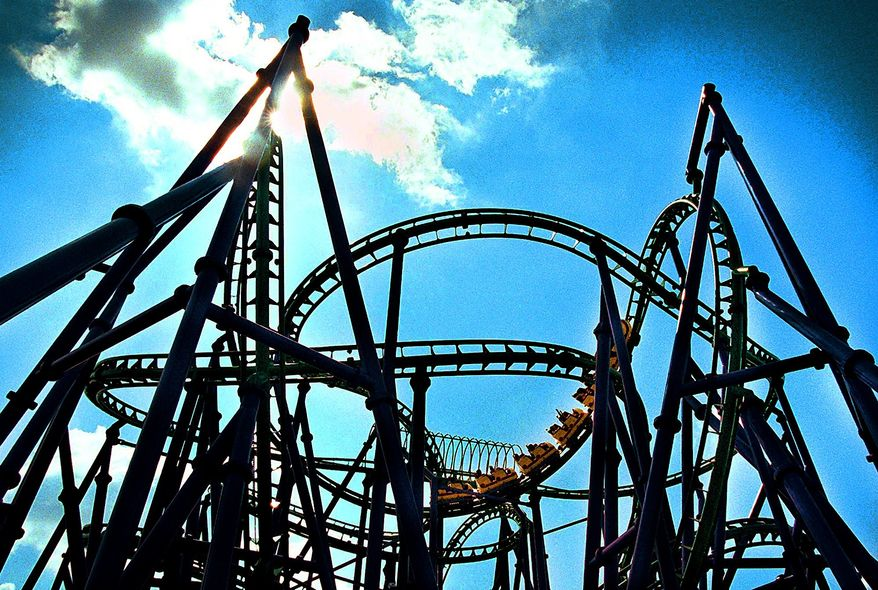 ** FILE ** People ride on the Joker's Jinx roller coaster at the Six Flags America Amusement Park in Largo, Md., in July 2002.