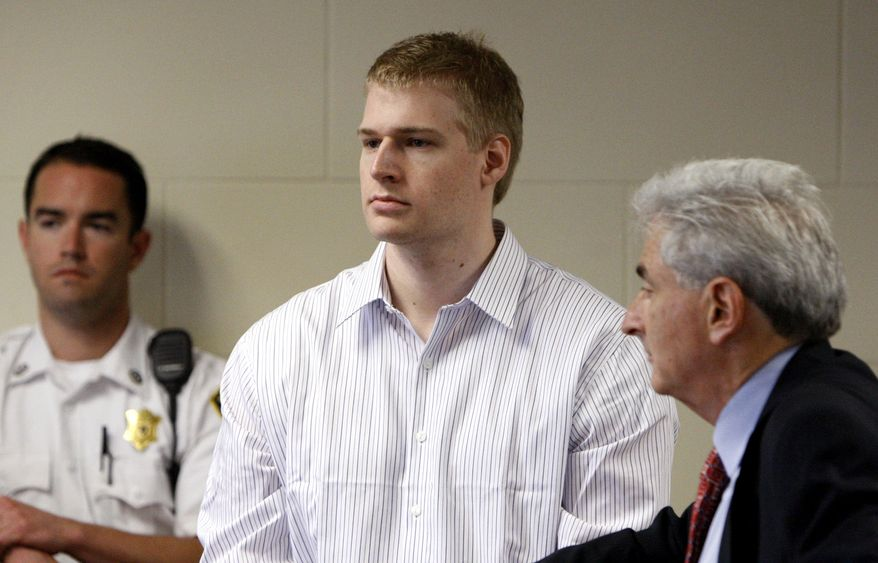 ** FILE ** Former Boston University medical student Philip Markoff (center) stands with his attorney, John Salsberg (right), during his arraignment in Suffolk Superior Court on Monday, June 22, 2009, in Boston. Mr. Markoff was charged with first-degree murder in the fatal shooting of one woman and the gunpoint robbery of another woman in downtown Boston hotels. (AP Photo/Bizuayehu Tesfaye, Pool)