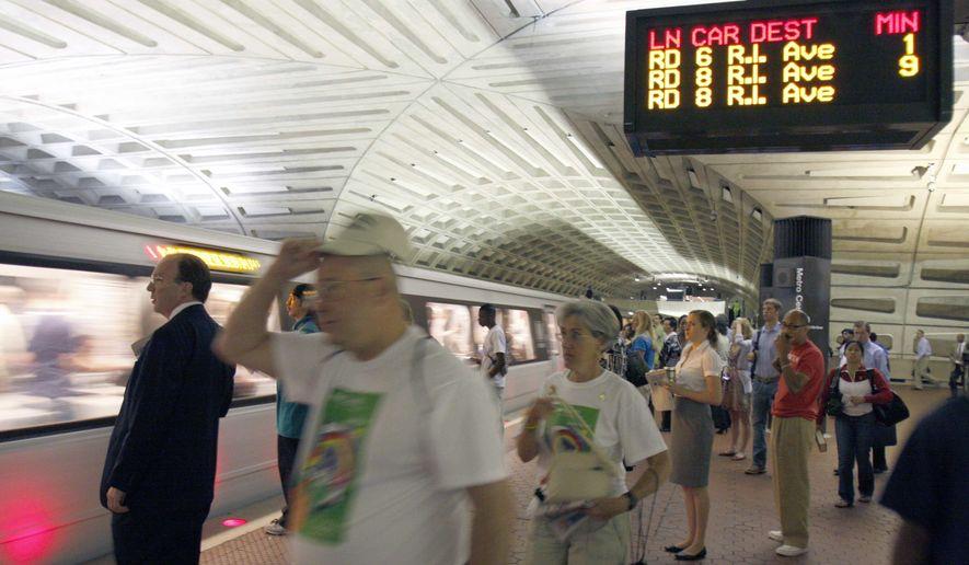 **FILE ** Passengers await a Red Line train at Metro's Metro Center station in Washington. (AP Photo/Harry Hamburg) **FILE**