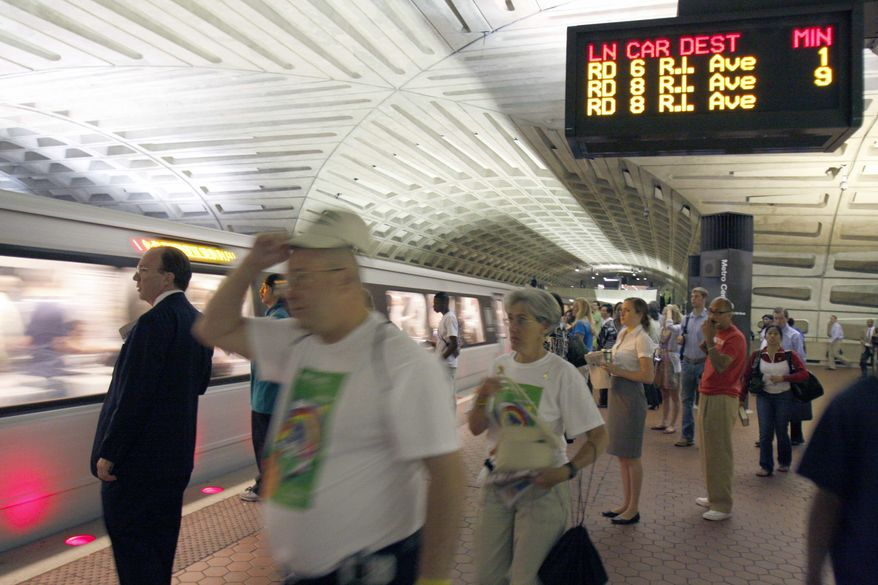**FILE ** Passengers await a Red Line train at Metro's Metro Center station in Washington. (AP Photo/Harry Hamburg) **FILE**