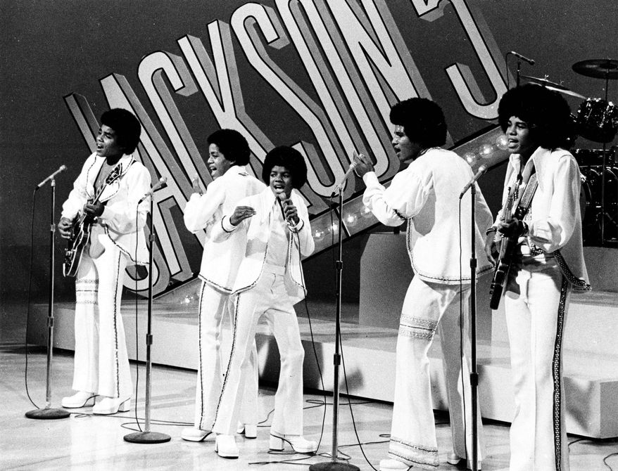 "In this Sept. 15, 1972 file photo, The Jackson 5, from left, Tito,  Marlon,  Michael, Jackie and Jermaine perform during the ""Sonny and Cher Comedy Hour"" in Los Angeles.  (AP Photo, file)"