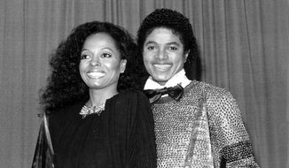 Singers Michael Jackson, right, and Diana Ross hold their American Music Awards in Los Angeles on Jan. 30, 1981. Jackson won for favorite soul album, and Ross won for favorite female soul vocalist. (AP Photo) ** FILE **