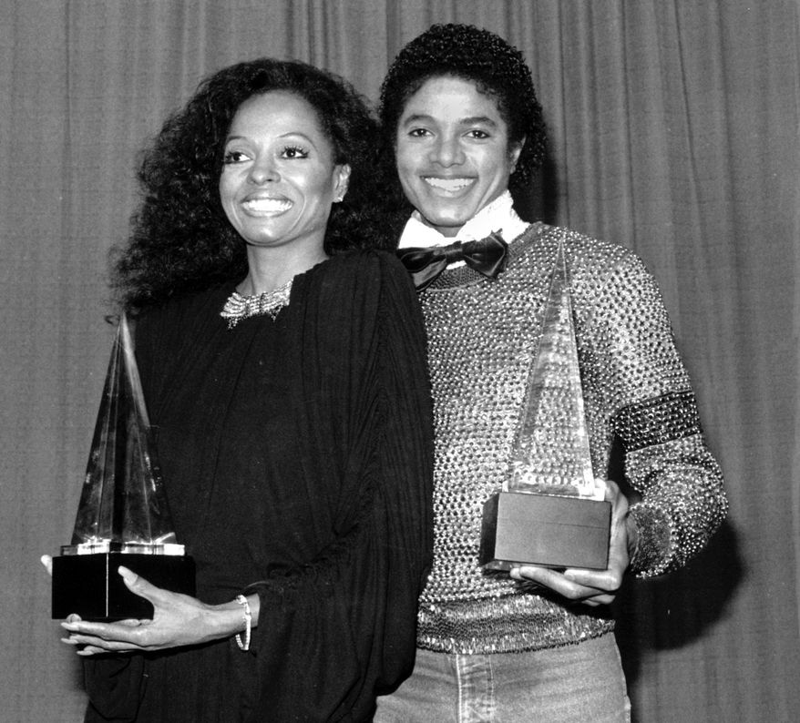 Singers Michael Jackson, right, and Diana Ross hold their American Music Awards in Los Angeles on Jan. 30, 1981.  Jackson won for favorite soul album and Ross won for favorite female soul vocalist.  (AP Photo)