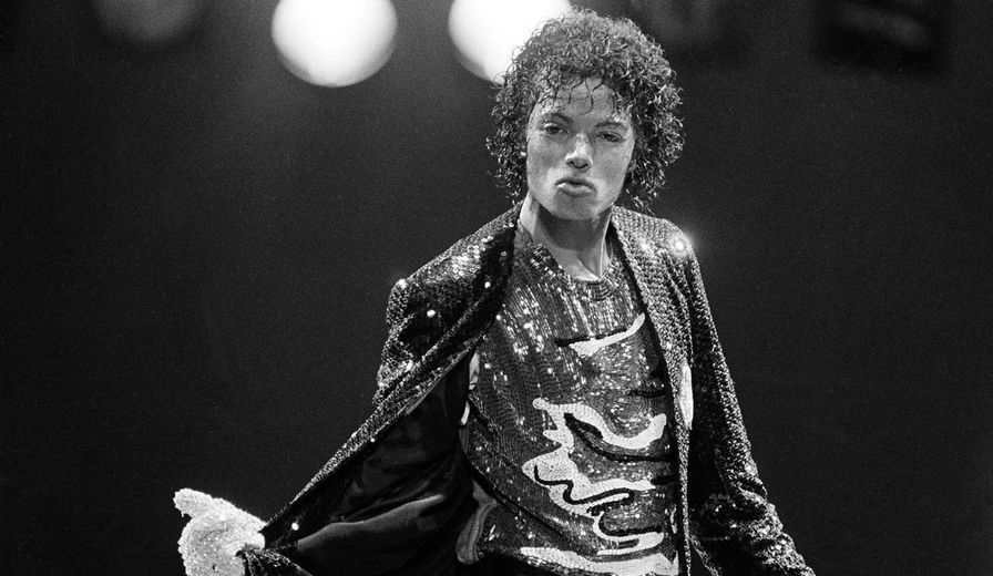 In this Dec. 1, 1984, file photo,  pop artist Michael Jackson, center, is shown onstage at opening night of his Victory Tour at Dodger Stadium in Los Angeles.  (AP Photo/Lennox McLendon, file)