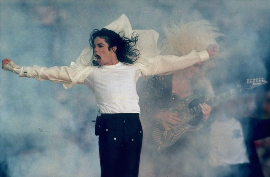 In this Jan. 31, 1993 file picture, Michael Jackson performs during the halftime show at the Super Bowl XXVII in Pasadena, Calif. Jackson has died in Los Angeles at age 50 on Thursday, June 25, 2009. (AP Photo/Rusty Kennedy)