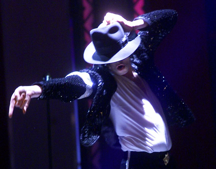 "** FILE ** Michael Jackson performs during his ""30th Anniversary Celebration, The Solo Years"" concert at New York's Madison Square Garden on Friday, Sept. 7, 2001. (AP Photo/Beth A. Keiser, Pool)"