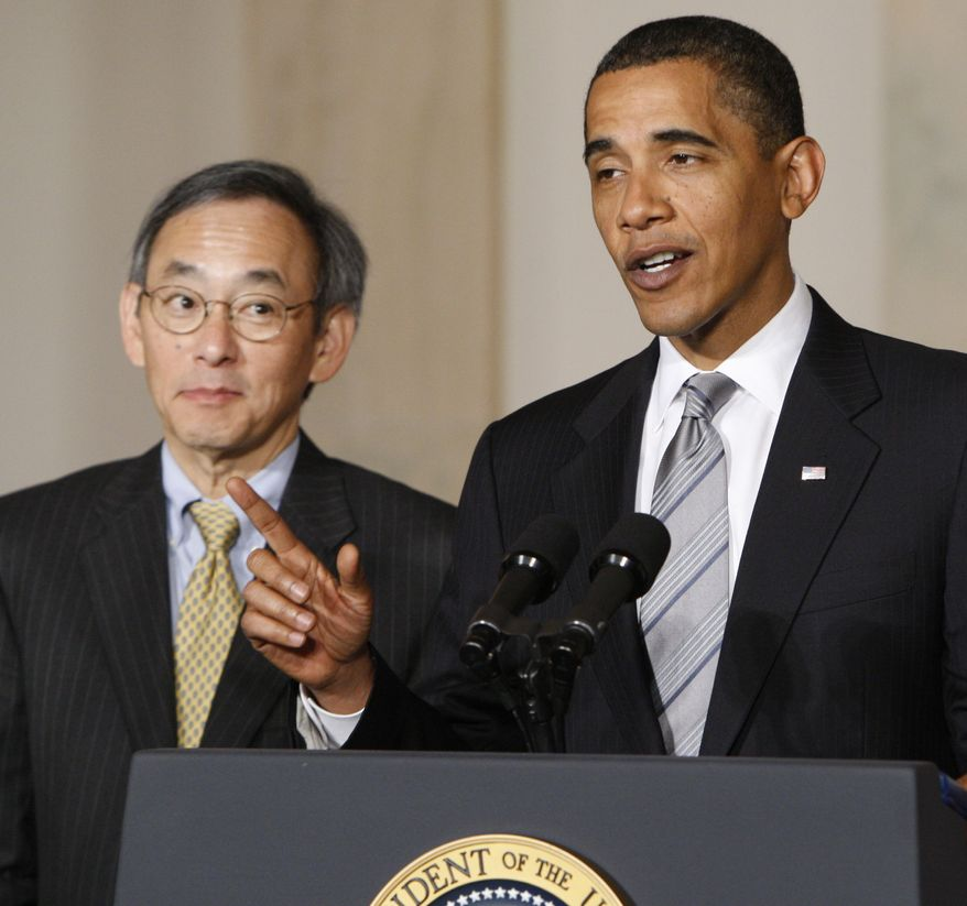 President Barack Obama, accompanied by Energy Secretary Steven Chu, delivers remarks on the energy bill, Monday, June 29, 2009, in the Grand Foyer of the White House in Washington. (AP Photo/Pablo Martinez Monsivais)