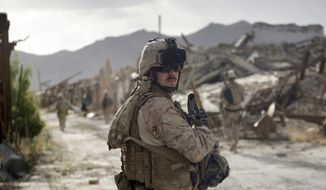 **FILE** In this photo taken Tuesday, June 23, 2009, U.S. Marine Capt. Zachary Martin, Golf Company commander of 2nd Battalion, 3rd Marines of the 2nd MEB patrols with a squad through the empty town of Now Zad in Afghanistan's Helmand province. Three years after its residents fled, the once bustling town of Now Zad is the scene of a stalemate between U.S. Marines and Taliban insurgents and an example of the challenges facing the U.S. administration even as it sends 21,000 extra Marines and soldiers to the south to try and turn around a bogged down, 8-year-long war. (AP Photo/David Guttenfelder)