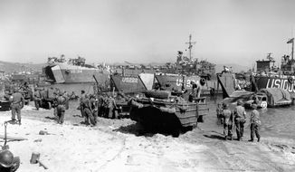 ASSOCIATED PRESS Endless tons of American weapons and supplies move ashore in Normandy after the successful landing of Allied forces on D-Day, June 6, 1944.