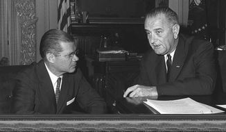 President Lyndon B. Johnson confers with Secretary of Defense Robert McNamara, November 23, 1963.