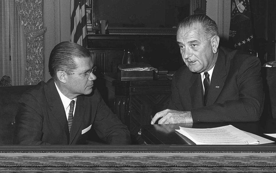 President Lyndon B. Johnson (right) confers with his secretary of defense, Robert McNamara. (AP Photo/ File)