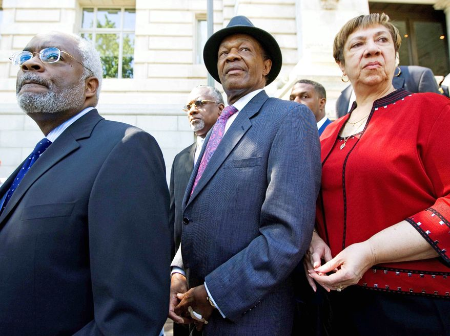 ** FILE ** This 2009 file photo shows D.C. Council member Marion Barry, flanked by his attorney, Frederick D. Cooke Jr., and his then chief of staff, Bernadette Tolson. (Associated Press)