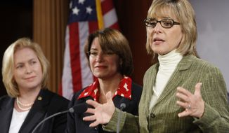 Sen. Barbara Boxer, D-Calif.,right, Sen. Amy Klobuchar, D-Minn., center, and Sen. Kirsten Gillibrand, D-N.Y, on Capitol Hill, Thursday, July 9, 2009, in Washington. (AP Photo/Ron Edmonds)