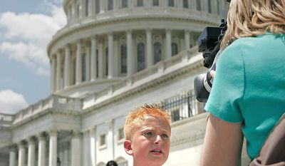 """LIZ ESSLEY/THE WASHINGTON TIMES Zach Bonner, 11, finishes a 1,225-mile walk to raise awareness about homeless children, telling the press on the steps of the Capitol that the issue has """"always been important to me."""" He just didn't know how """"large"""" the undertaking would be."""