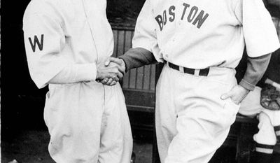 No Washington team has made the playoffs in the 77 years since Hall-of-Famer Joe Cronin (right, shown with Bucky Harris) was dealt to the Boston Red Sox in 1934. (Associated Press)