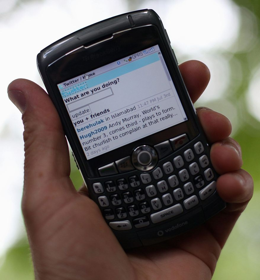 **FILE** The Twitter Web site is displayed on a mobile phone. (Getty Images)