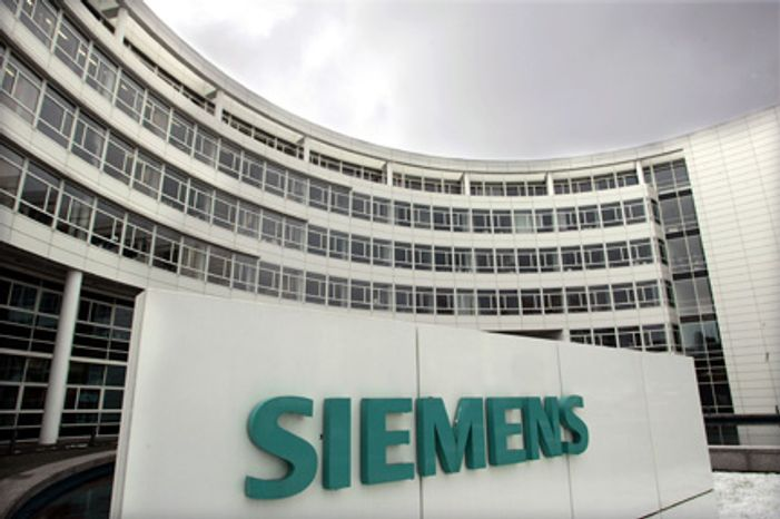 ** FILE ** Dark clouds hang above the Siemens headquarters in Munich in December 2006. (AP Photo/Diether Endlicher, File)