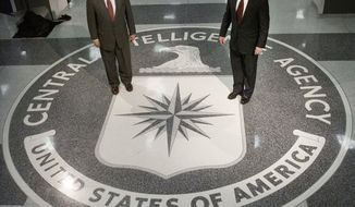 ** FILE ** On March 20, 2001, President George W. Bush (right) visits the Langley, Va., headquarters of the Central Intelligence Agency, where he thanked CIA employees for their service to their country and spoke of the importance of intelligence collection and analysis. At left is George J. Tenet, director of central intelligence from 1997 to 2004. (AP Photo/Pablo Martinez Monsivais)