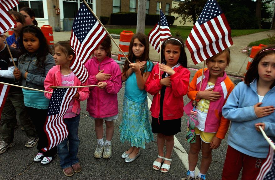 ** FILE **  Grade school students line the street of a Massachusetts town.