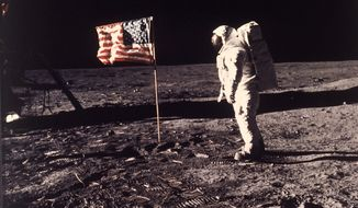 """** FILE ** In this July 20, 1969, photo, astronaut Edwin E. """"Buzz"""" Aldrin Jr. poses for a photograph beside the U.S. flag deployed on the moon during the Apollo 11 mission. (AP Photo/Neil Armstrong, NASA)"""