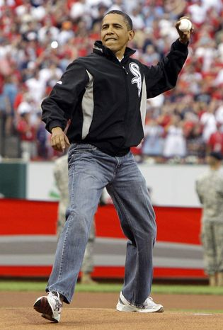 """** FILE ** President Obama throws out the first pitch to St. Louis Cardinals first baseman Albert Pujols (not pictured) before the Major League Baseball All-Star Game in St. Louis on Tuesday, July 14, 2009. Asked in an NBC """"Today"""" show interview about the well-worn bluejeans he wore at the game, Mr. Obama said, """"I hate to shop."""" (AP Photo/Haraz N. Ghanbari)"""