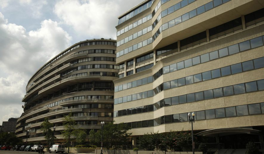 The Watergate Complex is seen in Washington, on Tuesday, July 21, 2009. The Watergate Hotel, part of a complex made famous by a presidential scandal, is heading to the auction block Tuesday. (AP Photo/Jacquelyn Martin)