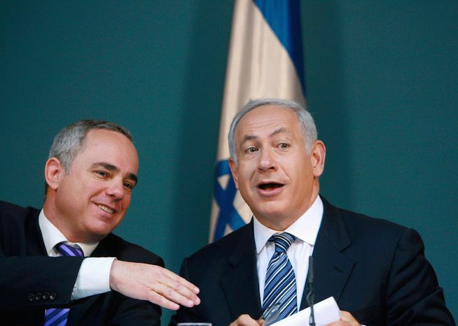 Yuval Steinitz (left), Israel's minister of strategic and intelligence affairs, is pictured with Israeli Prime Minister Benjamin Netanyahu.