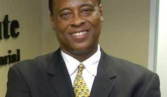 FILE - In this July 7, 2006 file photo, Dr. Conrad Murray poses for a photo as he opens the Acres Homes Cardiovascular Center at the Tidwell Professional Building, in Houston. (AP Photo/Houston Chronicle, File)