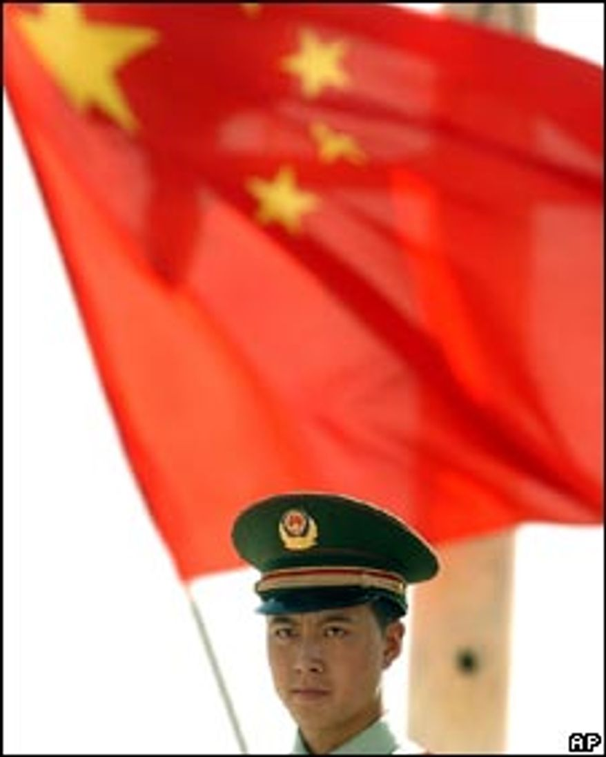 **FILE** A man carries a Chinese flag. (Associated Press)