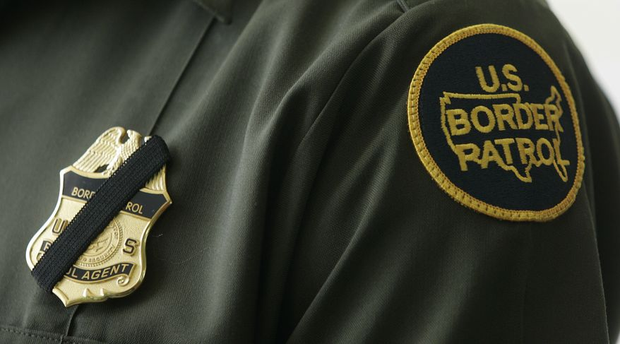 Black tape covers the badge of a United States Border Patrol Agent in the wake of the murder of agent Robert Rosas Friday, July 24, 2009, in Chula Vista., Calif. Agent Rosas was shot and killed late Thursday night in a confrontation on the border. (AP Photo/Lenny Ignelzi)