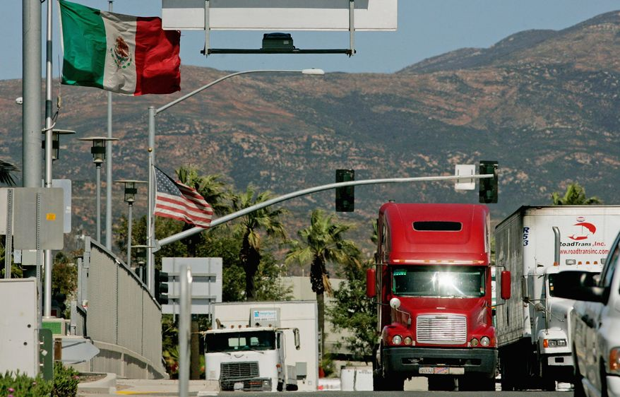 Trucks coming from Mexico prepare to enter the highway after crossing the border March 24, 2009 in Otay Mesa, California. (Photo by Sandy Huffaker/Getty Images) ** FILE **
