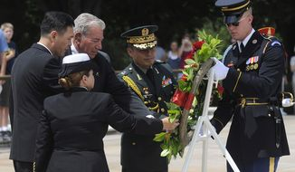 A wreath is laid during a ceremony marking the anniversary of the Korean War armistice at the Tomb of the Unknown Soldier at Arlington National Cemetery in Arlington, Va., Monday, July 27, 2009. (Peter Lockley / The Washington Times)