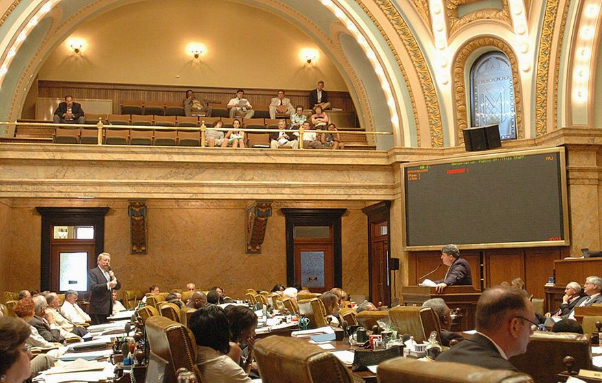 ** FILE ** Mississippi state Reps. Jeffrey C. Smith (left) and Greg Snowden debate a bill regarding budget appropriations for public utilities staff during a special session of the state Legislature on July 10, 2009. (Associated Press)