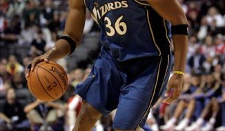 Former Washington Wizard Etan Thomas is doing his part to be a positive influence on fatherhood. (Associated Press)