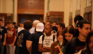Young voters waiting to cast their ballots. GETTY IMAGES