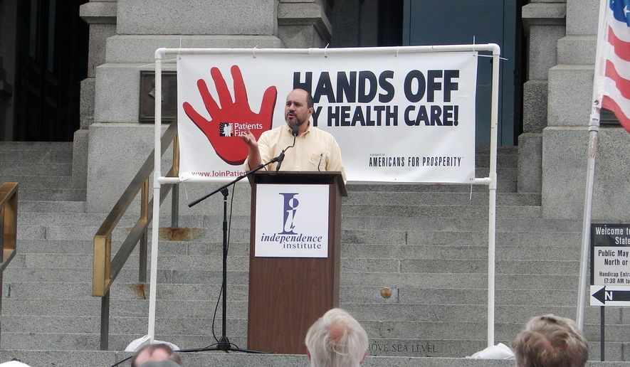 "In this file photo, Jon Caldara, president of the Independence Institute, fires up the crowd at Colorado's Capitol in Denver during a 2009 rally condemning President Obama's proposed health care plan. Mr. Caldara was recently let go from the Denver Post, where he had a regular opinion column. He says the liberal editor who terminated him did so because of his views on transgender rights issues being ""insensitive."" (Valerie Richardson/The Washington Times) **FILE**"