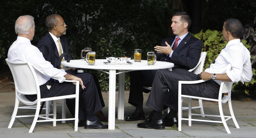 President Barack Obama, right, and Vice President Joe Biden, left, have a beer with Harvard scholar Henry Louis Gates Jr., second from left, and Cambridge, Mass., police Sgt. James Crowley in the Rose Garden of the White House in Washington Thursday, July 30, 2009.(AP Photo/Alex Brandon)