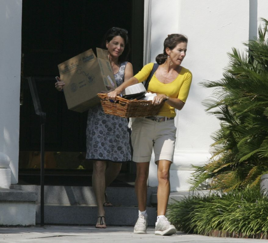 The wife of philandering South Carolina Gov. Mark Sanford, first lady,Jenny Sanford, in yellow top, carries out her belongings from the Governor's Mansion with help from an unidentified friend Friday, Aug. 7, 2009, in Columbia, S.C. First lady Jenny Sanford and several other woman moved clothing and boxes from the mansion in Columbia on Friday. In a statement, Sanford said she is moving to the family home on Sullivans Island, some 120 miles east, but will continue working on her marriage. (AP Photo/Mary Ann Chastain)