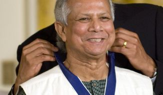 President Barack Obama awards the Medal of Freedom to Dr. Muhammad Yunus, a global leader in anti-poverty efforts, during a ceremony in the East Room at the White House, Wednesday, August 12, 2009.  