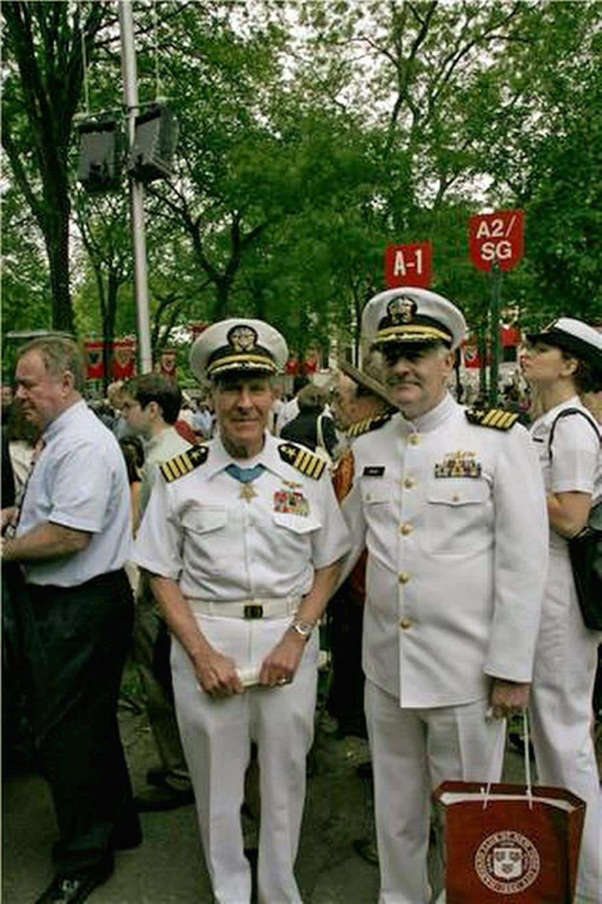 Capt. Tom Hudner Jr., USN (Ret.), a Medal of Honor recipient (left), and Capt. Paul E. Mawn, USN (Ret.), chairman of the Advocates for Harvard ROTC (right), are in the Harvard Yard at the June 3 ROTC commissioning ceremony. (Photograph provided by the Advocates for Harvard ROTC/Special to The Washington Times).
